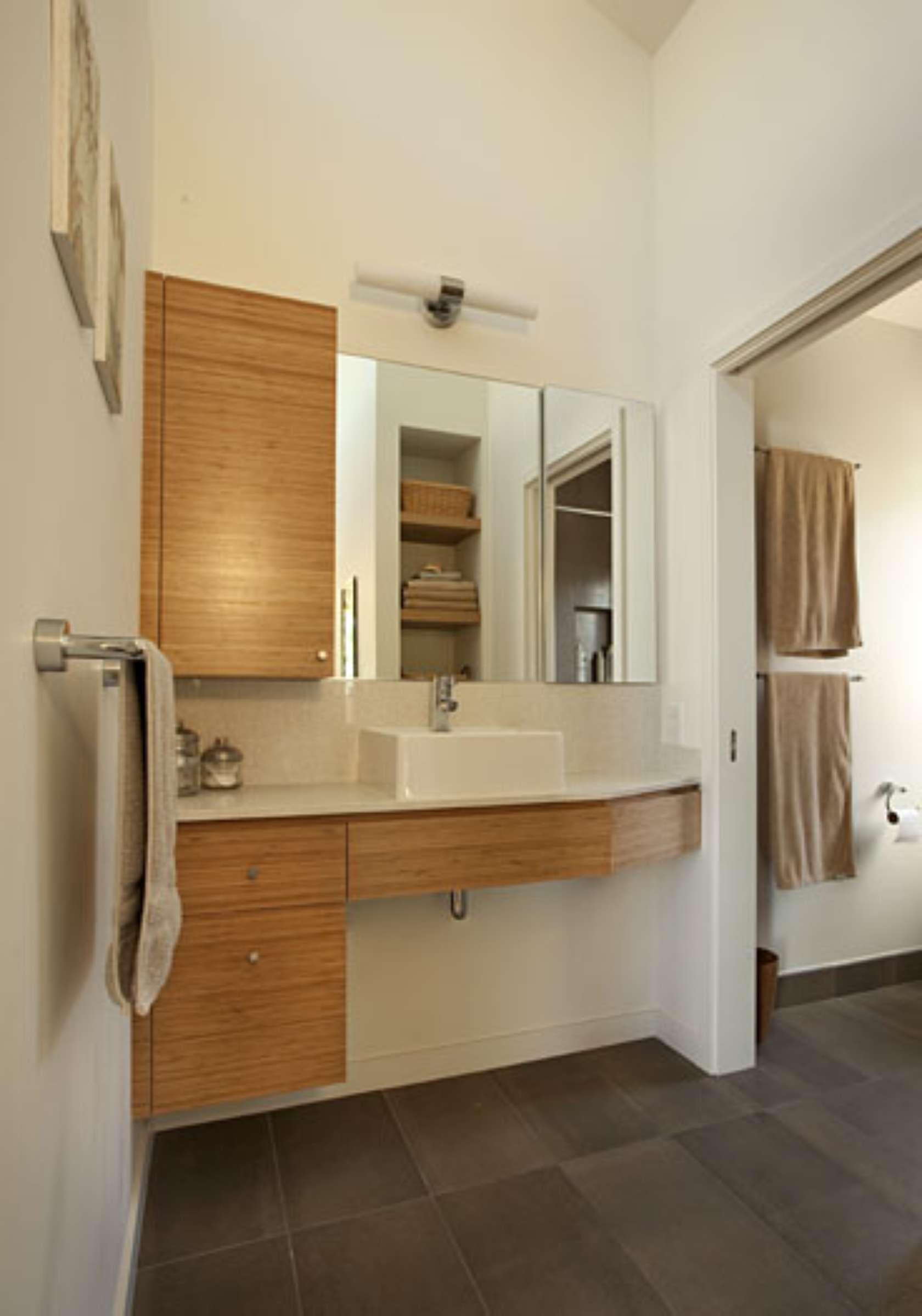 Modern ranch house conversion architizer for Modern ranch bathroom